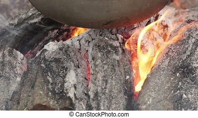 Cauldron on fire - Bottom of bowler for cooking over burning...
