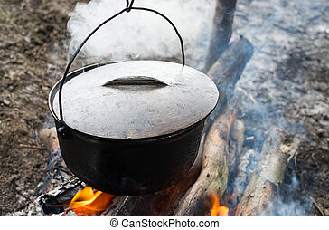 Cauldron on the open fire - Cooking in the cauldron on the ...