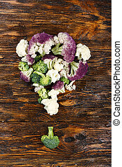 cauliflower and broccoli on a wooden background