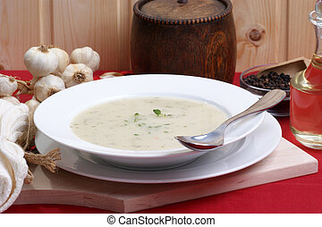cauliflower cream soup in a white bowl