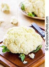 Cauliflower  - Fresh cauliflower by knife on chopping board