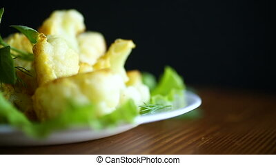 cauliflower fried in batter on a plate