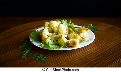 cauliflower fried in batter with greens and