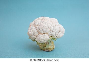 Cauliflower on blue background side view