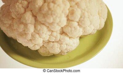 Cauliflower on green plate