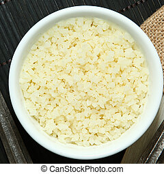 Cauliflower Rice Substitute - Riced Cauliflower in bowl at...