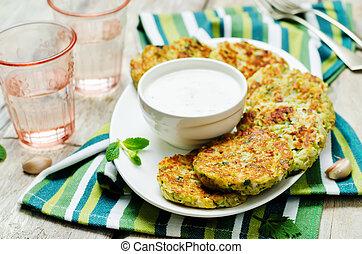 Cauliflower sweet potato Fritters with greek yogurt mint sauce