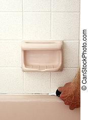 Caulking Between Bathtub and Wall