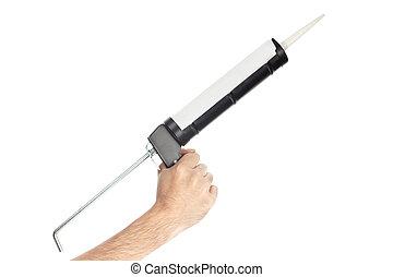 Caulking gun tool held by hand