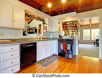 Cauntry farm house kitchen with wood ceiling.