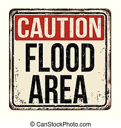 Caution flood area vintage rusty metal sign on a white...
