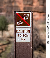 Caution Poison Ivy Sign warns hikers to stay out of...