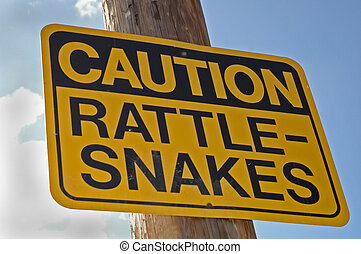 """Caution: Rattle-Snakes - """"Caution Rattle-Snake"""" sign hanging..."""