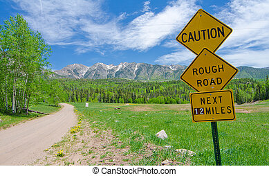 Caution: Rough Road Sign in the San Juan Mountains in Colorado