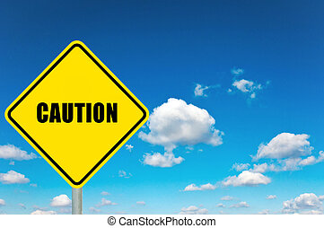 Caution sign - Caution yellow road sign with clouds and sky...