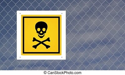 Caution sign - Do not enter on chain link fence against sky...