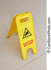 Caution sign for wet floor during cleaning. For cleaning and...