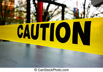 Caution text on yellow warning tape