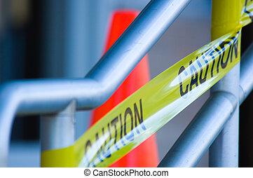 Caution tape with orange traffic cone