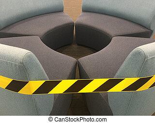 Caution warning tape on empty couches