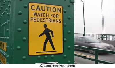Caution watch for pedestrians. - Handheld shot of...
