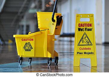 Caution Wet Floor - Mop bucket and caution sign