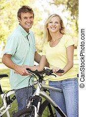 cavalcade, couple, parc, jeune, cycle
