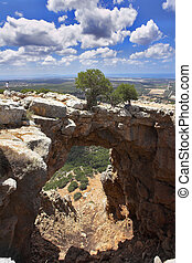 Cave and the natural bridge in mountains in the north of ...