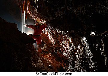 Cave explorer in the cave