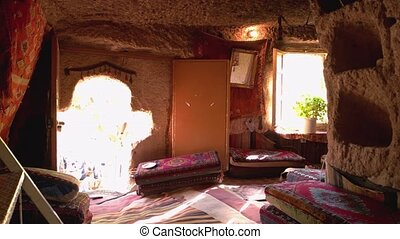 Cave house in tuff rock formation. Interior of traditional cave house at Cappadocia, Turkey.