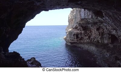 cave in montains on sea shore - cave deep in montains on sea...