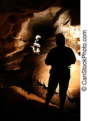 Cave passage with cave explorers