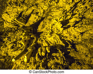 Cave Stalaktites - Underground cave with stalagmites and...
