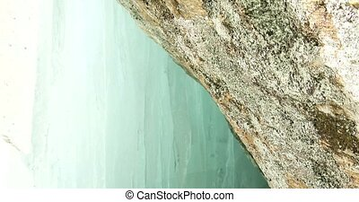 Cave underneath small icefall in Algonquin Provincial Park,...