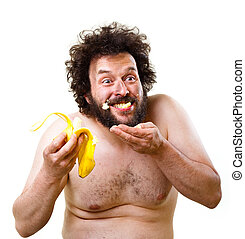 Caveman happy about having a banana to eat - Wild, undressed...