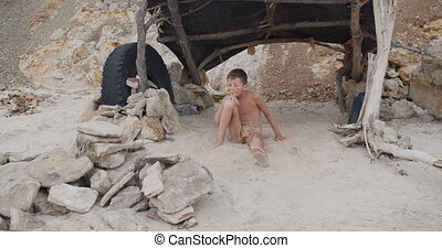 Caveman, manly boy. Funny young primitive boy outdoors....