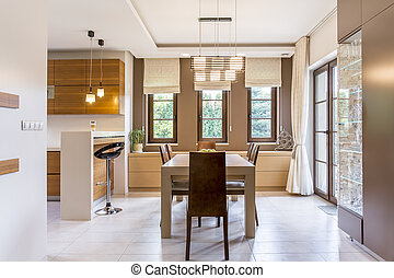 Cavernous and warm kitchen in a modern villa - Large dining...