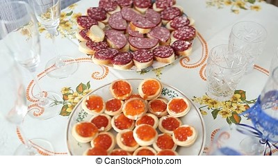 Caviar canape' on luxury table. Red Caviar And Fish Strawberries On Table. Beautifully Decorated Catering Banquet Table With Canape With Caviar. Salmon Steak And Red Caviar. Vegetable caviar in a white bowl on a grey concrete background. Picture of red caviar, loaf, butter on white table. Wedding