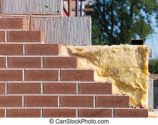 cavity wall insulation - wall under construction with...