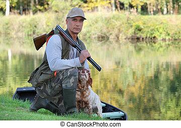 cazador, perro, agachado