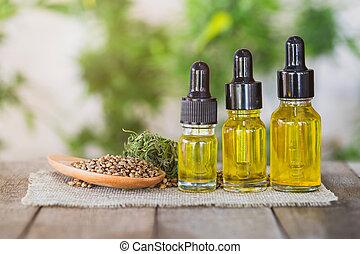 CBD oil hemp products in a glass jar and hemp seeds.