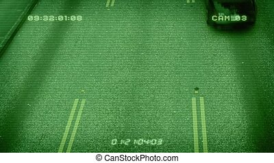 CCTV Above Busy Road - Overhead shot of cars passing...