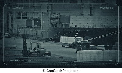 CCTV Busy Port With Workers Loading Ship - CCTV view of...