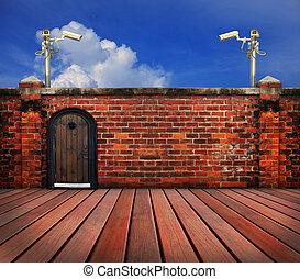 cctv camera and old brick wall