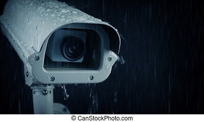 CCTV Camera Dripping In Rain - Tracking shot passing a CCTV...