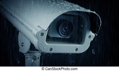 CCTV Camera In Heavy Rain - Closeup of CCTV camera in the...