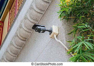 CCTV camera. Security camera on the wall