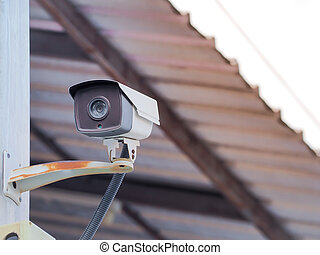 CCTV camera security on the old wall