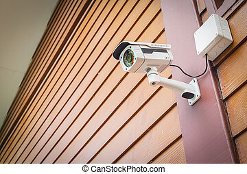 cctv camera security on wall background for safety concept