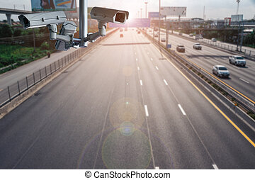 CCTV cameras on the overpass for recording on the road for safety and traffic violations.